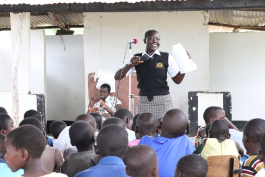 Debora proudly leads SRH outreach in a church