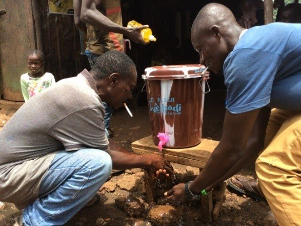Men using the new hand washing station