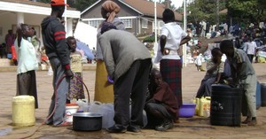 GEMINI photo-- families wait for water