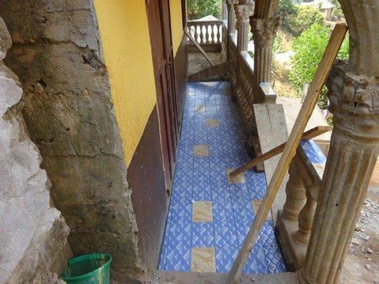 Laying tiles on the veranda