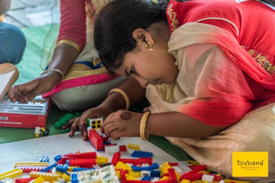 Focused & determined playing Building Blocks!