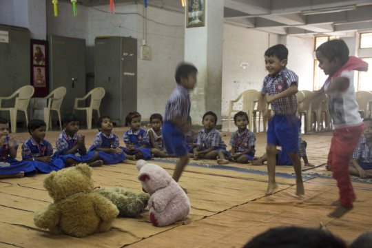 Kids during a Toybank toy distribution session