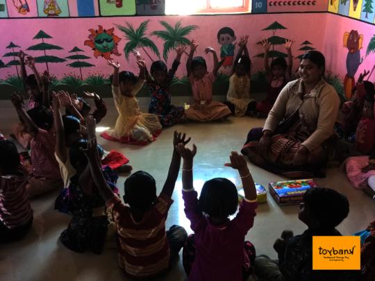 Children being taught through Play by a Teacher