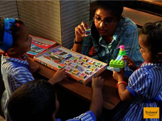 Our program officer teaching alphabet blocks