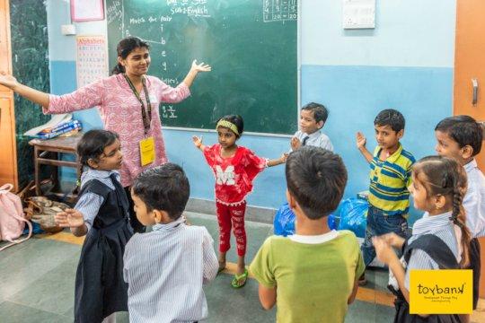 Volunteer conducting activities with the children