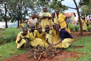 Schoolgirls Planting Fruit Trees