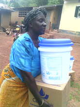 An excited woman carrying her purifier home