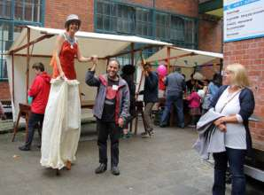one mentor walking on stilts