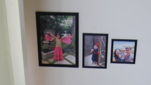 Pictures sent by adoptive parents fill the walls