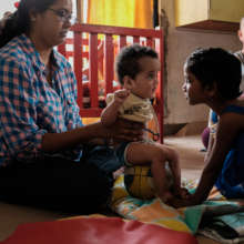 Infants with special needs receive physiotherapy