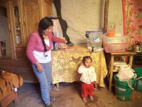 Mother with water filter at home