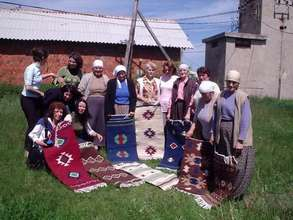 Particpants show off their hand-made rugs.