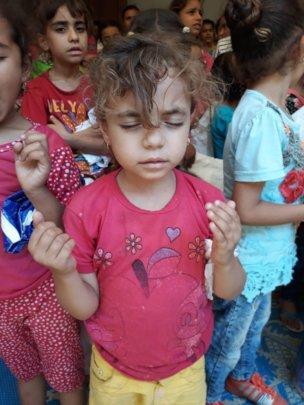 Children praying for the coronavirus to end