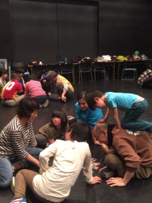 Children and adults creating stories together