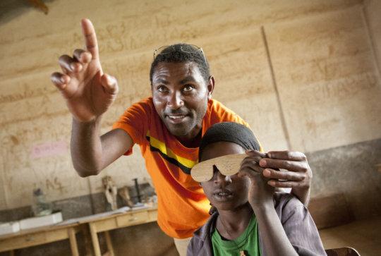 Teachers screen students at school in Ethiopia
