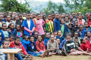 School children watch a play by the eye club