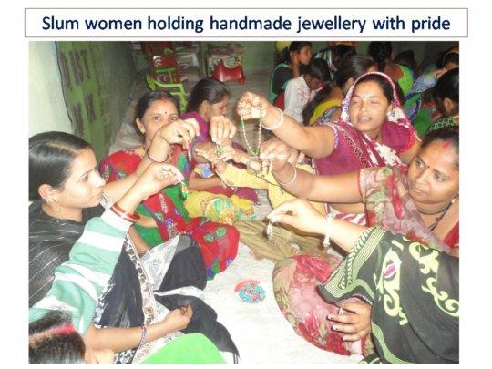 Slum women holding handmade jewellery with pride