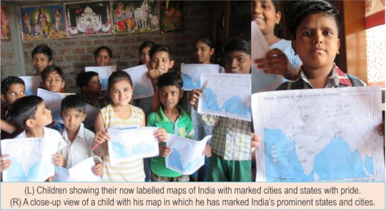 Children showing their labeled maps