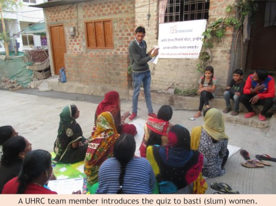 A UHRC team member introduces quiz to women