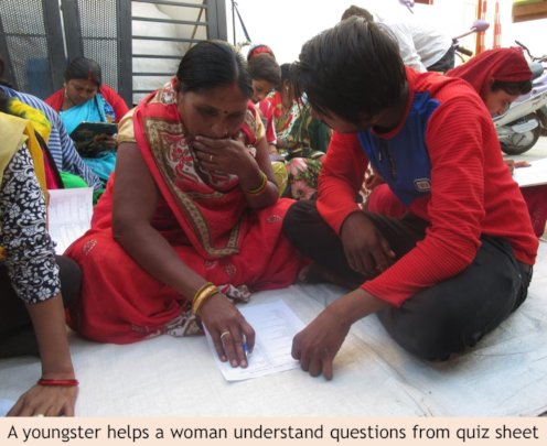 A youngster helping a woman understand questions