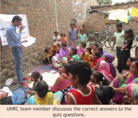 UHRC team member discusses answers with women