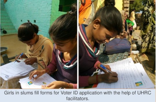 Girls filling application forms for Voter ID