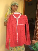 Slum Woman Shows Sewed Men's Shirt