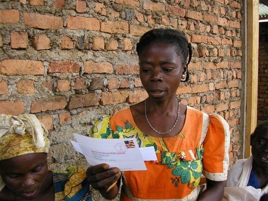 A Congolese woman reading a letter