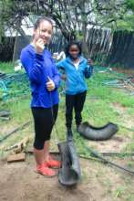 Camilla and Sibongile working on the swings