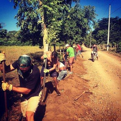 SFL Volunteers & community members trench digging