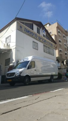Van in front of our offices, before tailoring