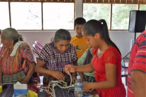 Fatima teaches community Circuits and Solar class