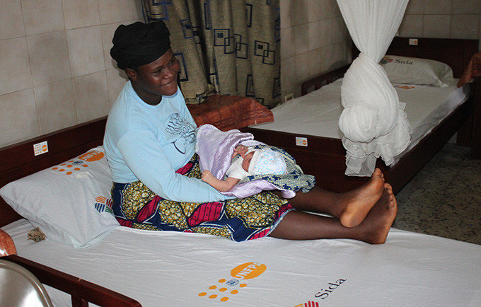A woman and her baby rest at a UNFPA clinic