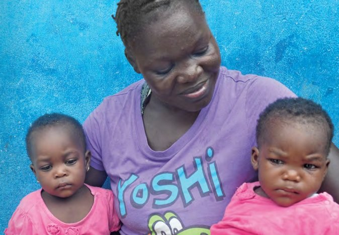 Woman and children assisted by UNFPA after Ebola