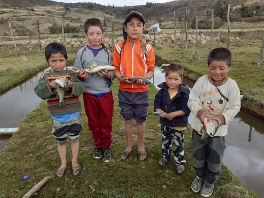 Local children with harvested trout