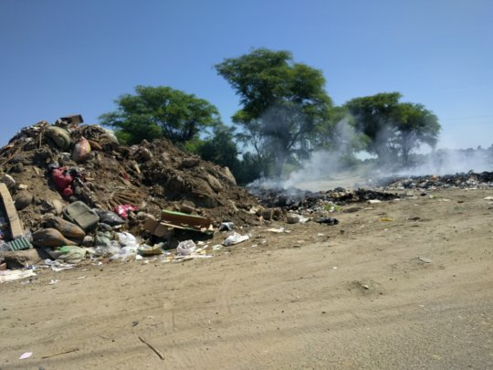 Piles of debris from the flooding dot the area