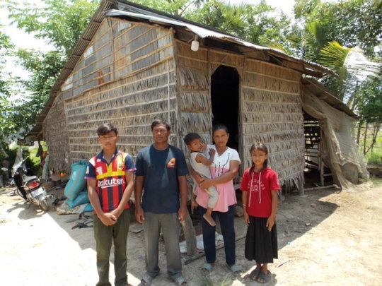 Farming Family next to their home