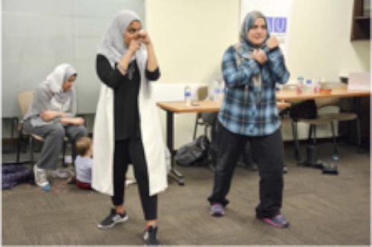 Immigrant women participate in fitness class
