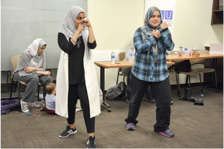 Immigrant women participate in fitness class