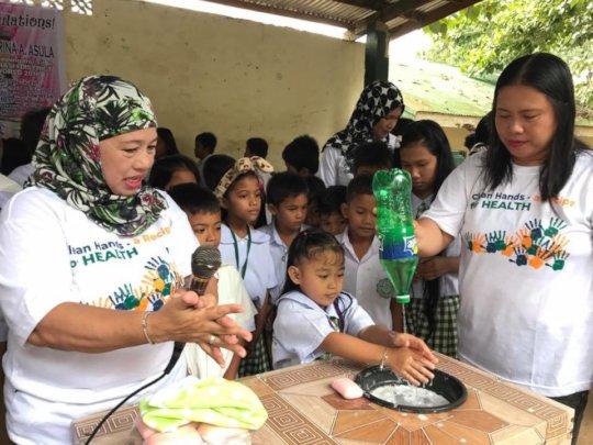Hand wash in rural school using plastic bottle