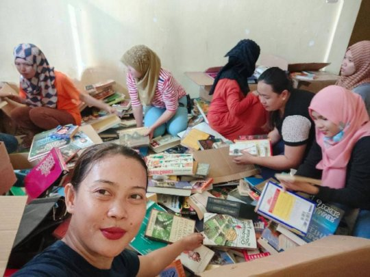 Teachers selecting books for their schools