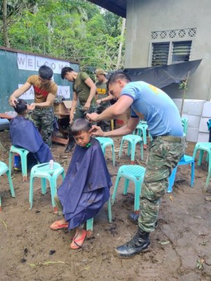 Local military provides haircuts for children