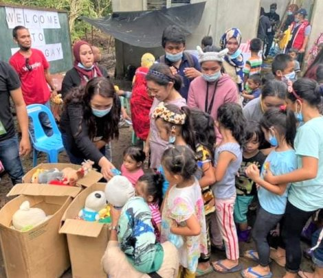 Children receive a toy at homecoming event