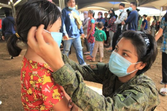 Villagers receive AAI masks from military partners