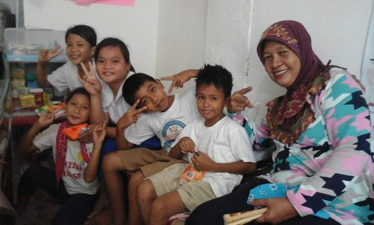 Munting Mini Nurses and their mentor at clinic