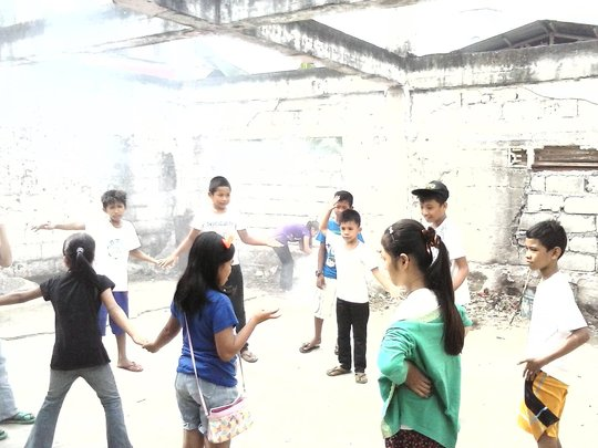 Playing in the ruins of the burned schoolhouse