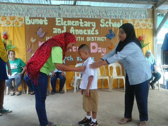 Honor student receives award from Mom and Teacher
