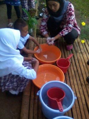 Teacher instructing kids on value of soap
