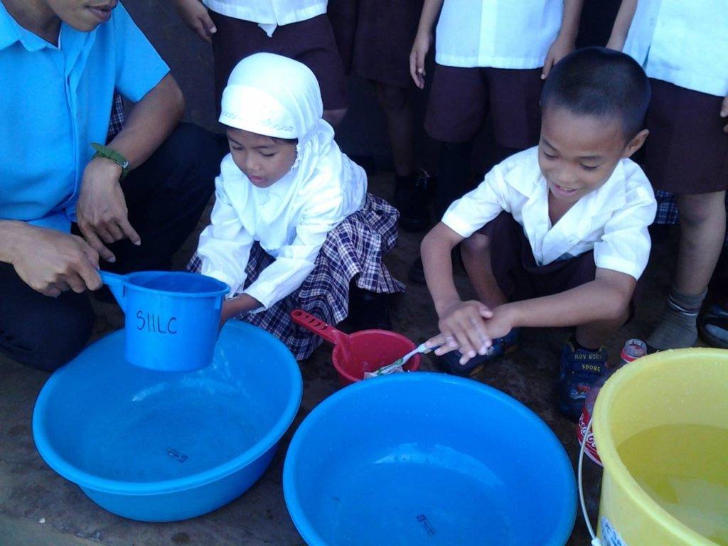 First Grade children washing at Sahaya Elementary