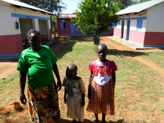 A widow with her orphans in a photo at our office